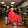 Barber Dick Robbins of North Reading cuts the hair of Ed Cosco of Revere in the new addition to George's Barber Shop in Saugus.