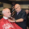 Barber Dick Robbins of North Reading trims the beard of Ed Cosco of Revere in the new addition to George's Barber Shop in Saugus.