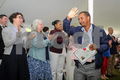 Robert Layman / Staff Photo Ibrahim Mohamed Ardi, formerly of Somalia and now Burlington, waves to the crowd after recieving his certificate of citizenship during a naturalization ceremony at Plymouth Notch July 4, 2017. Over twenty new citizens were sworn in on Independence Day from 10 countries.