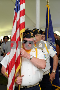 Robert Layman / Staff Photo Steve Kipp of Rutland's American Legion Post 31 retires the colors after a naturalization ceremony at the  President Calvin Coolidge State Historic Site in Plymouth Notch July 4, 2017.