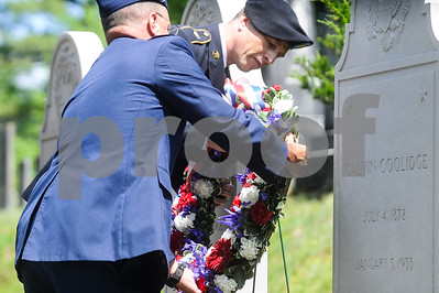 Robert Layman / Staff Photo Members of the Vermont National Guard lay a wreath at the gravesite of President Calvin Coolidge at Notch Cemetery in Plymouth July 4, 2017. A ceremony was held to honor Independence Daym which was also President Coolidge's birthday.