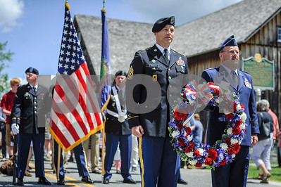 Robert Layman / Staff Photo Members of the Vermont National Guard stand with a wreath from the White House before marching to Notch Cemetery and placing it at the gravesite of President Calvin Coolidge.