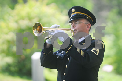 Robert Layman / Staff Photo Staff Sgt. Chad Jenkins of the Vermont National Guard plays taps at Notch Cemetery in Plymouth following the wreath laying for Calvin Coolidge on July 4, 2017.