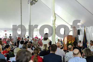 Robert Layman / Staff Photo Matthew Denhart, right, Executive Director for the Coolidge Foundation, gives remarks before the naturalization ceremony at Plymouth Notch, July, 4, 2017.