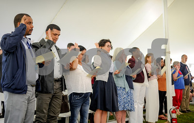Robert Layman / Staff Photo Twenty new citizens from over ten countries are sworn in during theri naturalization ceremony at Plymouth Notch, July 4, 2017.