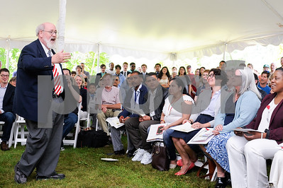 Robert Layman / Staff Photo Bill Wiles of the Castleton Collegiate Chorale, sings patriotic songs with twenty new citizens and the crowd at a naturalization ceremony at the President Calvin Coolidge State Historic Site in Plymouth Notch July 4, 2017.