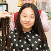 Sammi Nie, 13, holds up her hair that she will be donating to Locks for Love.