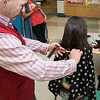 Stylist Jhon (correct spelling) Munera cleans up 10-year-old Rymas Aladmawy's hair after cutting off 10 inches for Locks for Love.