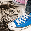 A pile of hair clippings sits at stylist Jhon Munera's feet during the Locks for Love charity event at Salemwood School in Malden on Saturday.
