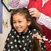 Rymas Aladmawy, 10, holds up her hair that she will be donating to Locks for Love during a charity event at Salemwood School in Malden on Saturday.