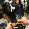 Sammi Nie, 13, gets the rest of her hair cleaned up after having 10 inches of it cut off and donated to Locks for Love.