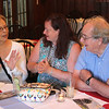 "Nahant, Ma. 6-28-17. Sheila Golden, left, Annette Sykes, and Ron Liesner from St. Louis, chat at the fundraiser called "" Night in Nahant: A Summer Party for the Lynn Museum/LynnArts""  held at the historic Nahant Country Club."
