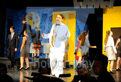 "Jeb Wallace-Brodeur / Staff Photo Accompanied by a live band, senior Evan Lewis sings a number in the Montpelier High School Masque presentation of ""How to Succeed in Business Without Really Trying."" The show, directed by Kianna Bromley, opened Thursday night and has performances tonight and Saturday night at 7 p.m., at the school."