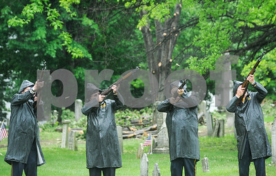 Robert Layman / Staff The firing squad from Rutland City's VFW Post 648 shoots blank rounds before the closing of the Memorial Day  ceremony at the West Street Cemetery Monday morning.