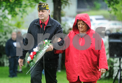 Robert Layman / Staff Photo Tom Allen, commander for Rutland's VFW Post 648, walks with post auxillary presdient Darlene Farwell to lay the tribute wreath during the West Street Cemetery Memorial Day Service Monday morning.