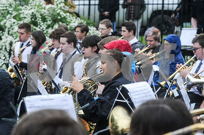 Robert Layman / Staff Photo The Rutland High School band braves the elements and plays during the Memorial Day Ceremony at the West Street Cemetery Monday morning.