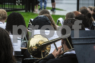 Robert Layman / Staff Photo A trombone covered in raindrops plays God Bless America during the Memorial Day Ceremony at the West Street Cemetery Monday morning.