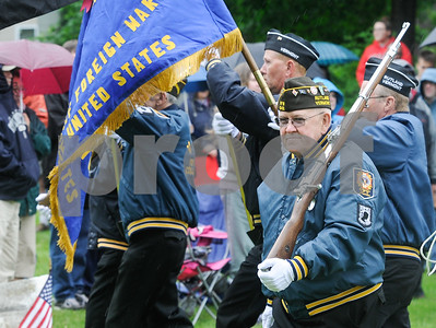 Robert Layman / Staff Photo The color guard from Rutland City's VFW Post 648 opens the Memorial Day Ceremony at the West Street Cemetery Monday morning.