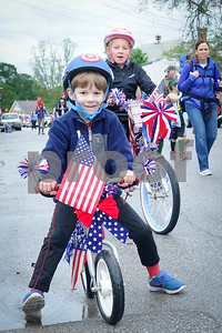 Robert Layman / Staff Photo Brady Kennedy, 4, of Rutland rides his bike during the Memorial Day Parade in West Rutland Monday morning.