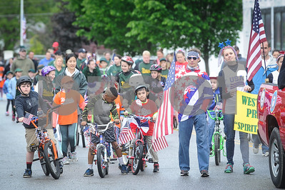 Robert Layman / Staff Photo Students from West Rutland School ride their decorated bikes through the Memorial Day Parade as it moves through Marble Street.