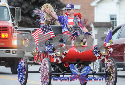 Robert Layman / Staff Photo An old motor car decked out in festive regalia putts down Marble Street during the Memorial Day Parade in West Rutland Monday morning.