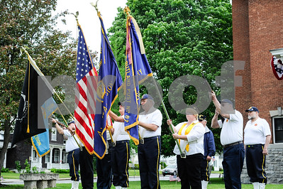 Robert Layman / Staff Photo The color guard from the West Rutland American Legion salutes before taps is played outside the town hall during the Memorial Day Parade Monday.