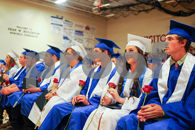 Robert Layman / Staff Photo Mill River Union High School class of 2017 sits with their diplomas and roses after walking the stage Wednesday night.