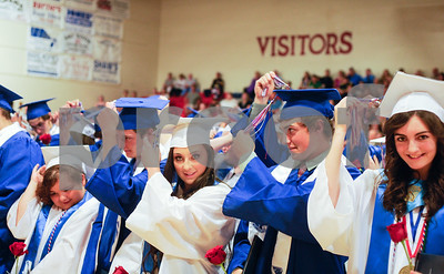 Robert Layman / Staff Photo Mill River Union High School class of 2017 seniors turn their tastles after walking the stage after their graduation ceremony Wednesday night.