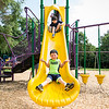 Ryan Sherlock, 4, of Nahant comes down the slide at Flash Road Playground as Jamieson McNamee, 4, of Nahant waits his turn at the top  during the Builder's Club and Giant Game Day hosted by Nahant Public Library on Wednesday.