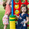 Lucy Bell, 6, of Nahant, left, and Annie McNamee, 1, of Swampscott, play giant Connect 4 during the Builder's Club and Giant Game Day hosted by Nahant Public Library on Wednesday.