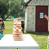 Marina Maddocks, 8, left, and Nora Bishop, 8, both of Nahant take a step back as their giant Jenga game comes toppling down  during the Builder's Club and Giant Game Day hosted by Nahant Public Library on Wednesday at Flash Road Playground.