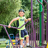 Ryan Sherlock, 4, of Nahant climbs on the jungle gym at Flash Road Playground during the Builder's Club and Giant Game Day hosted by Nahant Public Library on Wednesday.