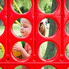 Lucy Bell, 6, of Nahant cleans up after a game of giant Connect 4 during the Builder's Club and Giant Game Day hosted by Nahant Public Library on Wednesday at Flash Road Playground.