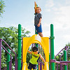 David Foster Jr., 5, of Nahant climbs to the highest point on the jungle gym at Flash Road Playground as Ryan Sherlock, 4, of Nahant gets ready to go down the slide  during the Builder's Club and Giant Game Day hosted by Nahant Public Library on Wednesday.