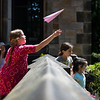 Nora Bishop, 8, of Nahant, throws her paper airplane off of the porch of the Nahant Public Library.
