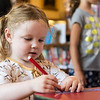 Adelaide Howell, 3, of North Reading, writes down the names of books she read this summer and creates a paper chain during Paperpalooza  at Nahant Public LIbrary on Wednesday.