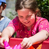 Nora Bishop, 8, of Nahant tries to float her paper boat during Paperpalooza at the Nahant Public Library on Wednesday.