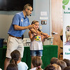 "Nick ""Nature Nick"" Jacinto hands Skylar Ross, 8, of Saugus a milk snake during his demonstration at Saugus Public Library on Friday."