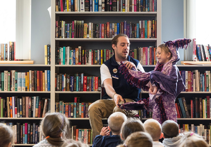 Danny Trifone of the New England Aquarium and his volunteer assistant, Layla DeMonte, 6, of Saugus show kids how a sea star eats at the Saugus Public Library on Thursday.
