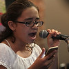 Lynn, Ma. 5-8-17. Alecia Lardiere was one of the people performing at the open mic evening at the Land of 1000 Hills.