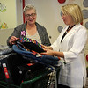 Lynn, Ma. 8-28-17. Deb Ansourlian, Executive Director of Girl's Inc. and State Rep Lori Ehrlich look at the new backpacks that will be given to girls at Girl's Inc.