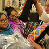 Lynn, Ma. 8-28-17. Fiorella Giraldo and Araceli Giraldo receive new backpacks from State Rep Lori Ehrlich and Deb Ansourlian, Exectutive director of Girl's Inc.