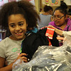 Lynn, Ma. 8-28-17. AShley Cabrera receives her new backpack from State Rep Lori Ehrlich at Girl's Inc. compliments of Spur of Marblehead.