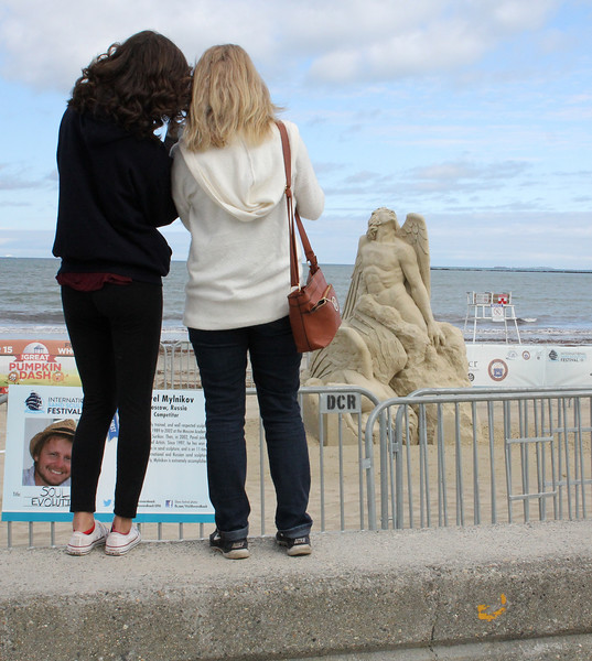 Revere, Ma. 7-25-17. Christina and Charlene Capone photograph the sand sculptures on Revere Beach today.