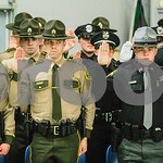Robert Layman / Staff Photo New law enforcement officers take their oath before the lowering ceremony at the 103rd  Basic Training Graduation.