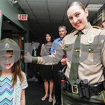 Robert Layman / Staff Photo Trooper Charlotte Hartman lets her niece Lexie Gaboriualt try on her uniform hat before graduating from the Vermont Police Academy Friday morning.