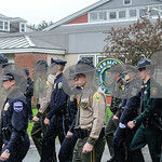 Robert Layman / Staff Photo Officers march to the flag for their final lowering ceremony before reporting for Duty at the Vermont Police Academy.