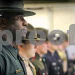 Robert Layman / Staff Photo University of Vermont police officer Kariym Azeez stands to attention duiring the 103rd Basic Training graduation ceremony.