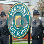 Robert Layman / Staff Photo New members of the Milton Police Department pose next to the Vermont Police Academy Sign after graduating from basic training Friday afternoon.