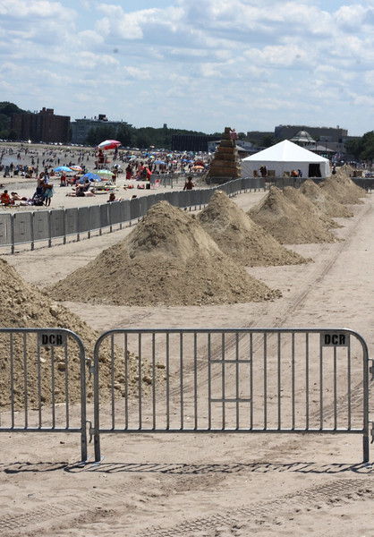 Revere, Ma. 7-16-17 Each of these piles of sand will be used for the sand castle competition on Revere Beach.